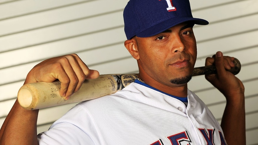 SURPRISE, AZ - FEBRUARY 28:  Nelson Cruz #17 of the Texas Rangers poses during spring training photo day on February 28, 2012 in Surprise, Arizona.  (Photo by Jamie Squire/Getty Images)