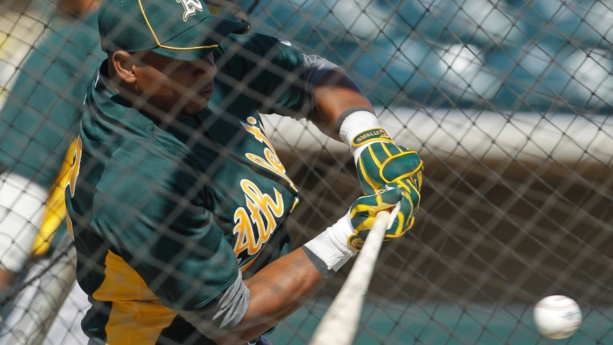 Oakland Athletics' Yoenis Cespedes hits during a baseball spring training workout Sunday, March 4, 2012, in Phoenix. (AP Photo/Darron Cummings)