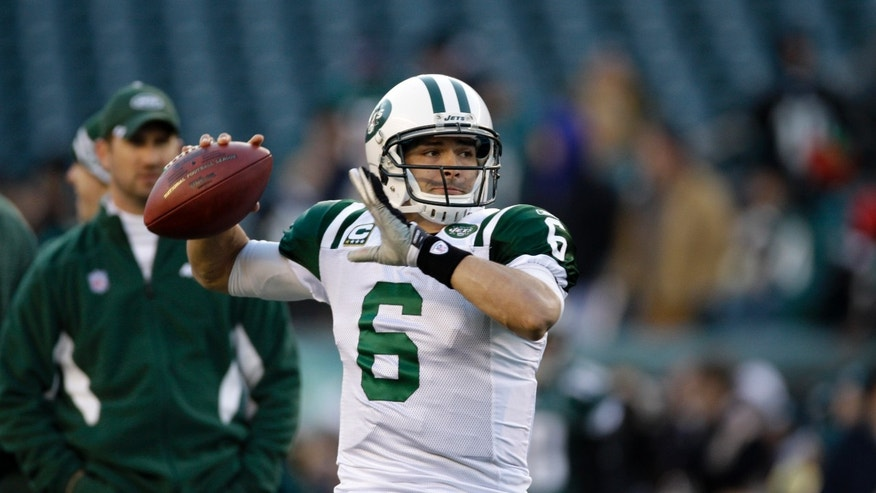 "FILE - In this Dec. 18, 2011, file photo, New York Jets quarterback Mark Sanchez throws a pass before an NFL football game with the Philadelphia Eagles in Philadelphia. The Jets have extended quarterback Sanchez's contract and dropped out of pursuing free agent Peyton Manning. The team announced the extension for Sanchez in a conference call Friday night, March 9, 2012, and general manager Mike Tannenbaum says the Jets ""looked at"" going after Manning before deciding to stick with Sanchez.  (AP Photo/Matt Slocum, File)"