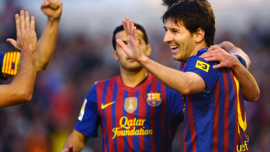 FC Barcelona's Lionel Messi, from Argentina, reacts after scoring against Racing Santander during their Spanish La Liga soccer match at Sardinero stadium in Santander northern Spain, Sunday, March 11, 2012. (AP Photo/Juan Manuel Serrano Arce)