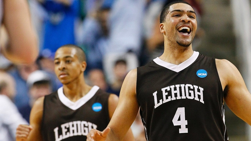 Lehigh's John Adams (4) and C.J. McCollum (3) celebrate after winning an NCAA tournament second-round college basketball game against Duke in Greensboro, N.C., Friday, March 16, 2012. Lehigh won 75-70. (AP Photo/Gerry Broome)