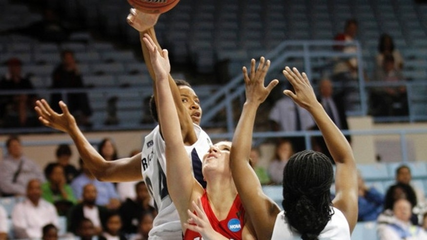 March 18: Fresno State guard Madison Parrish (11) drives to the basket past Georgetown's Amanda Reese (24) and Sugar Rodgers (14) during an NCAA women's college basketball tournament first-round game in Chapel Hill, N.C.