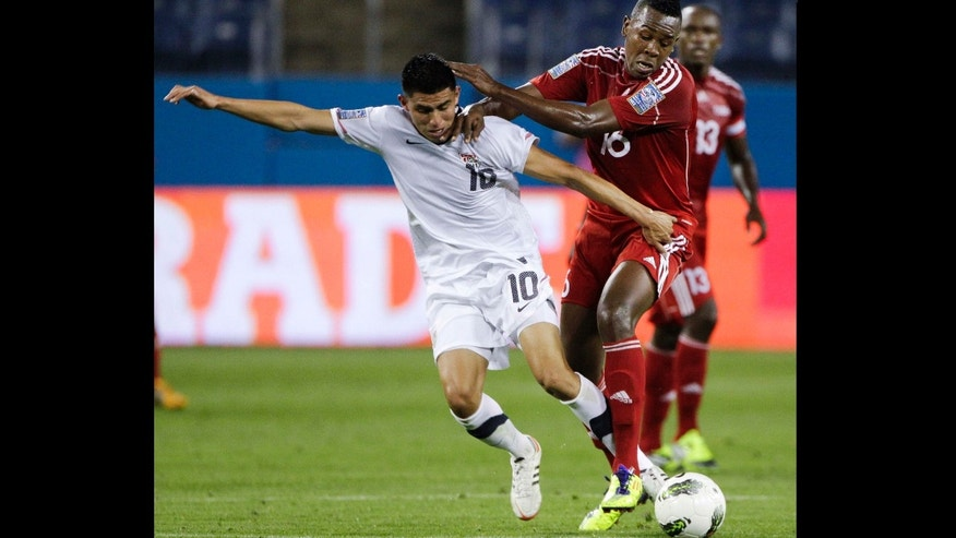 United States midfielder Joe Corona (10) vies for the ball with Cuba's Heviel Cordoves (16) in the first half of a CONCACAF Olympic qualifying soccer match on Thursday, March 22, 2012, in Nashville, Tenn.