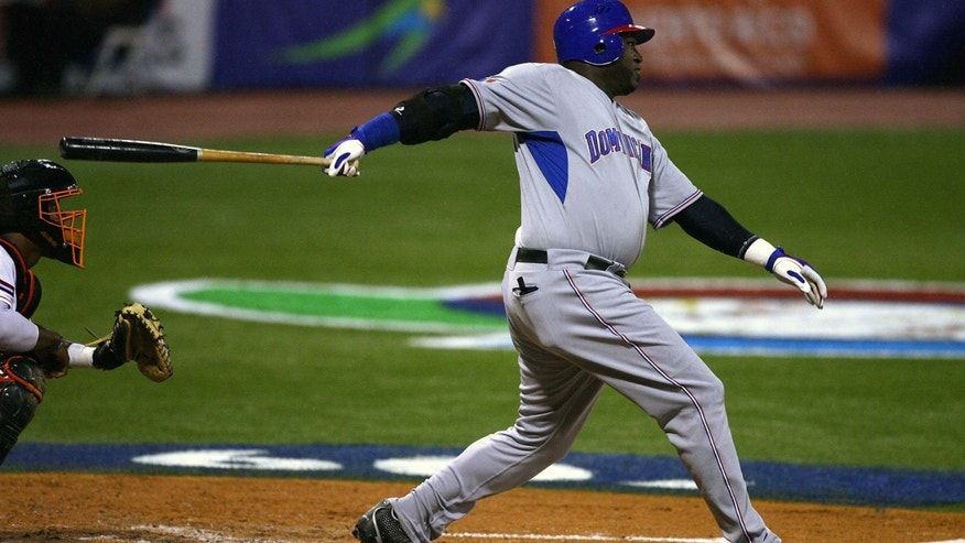 SAN JUAN, PUERTO RICO - MARCH 10:  David Ortiz #34 of the Dominican Republic hits a double against the Netherlands during the 2009 World Baseball Classic Pool D match at Hiram Bithorn Stadium March 10, 2009 in San Juan, Puerto Rico.  (Photo by Al Bello/Getty Images)