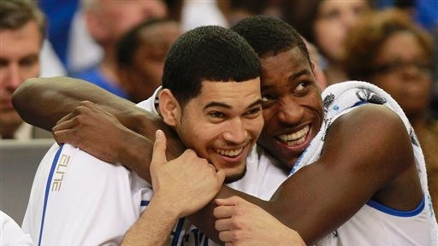 March 25: Kentucky's Eloy Vargas, left, and Michael Kidd-Gilchrist reacts in the closing seconds of the NCAA tournament South Regional final college basketball game against Baylor in Atlanta.