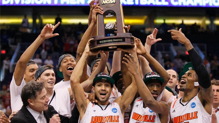 Louisville head coach Rick Pitino, left, and his team hoist the game trophy as they celebrate their 72-68 win over Florida in an NCAA tournament West Regional final college basketball game, Saturday, March 24, 2012, in Phoenix. (AP Photo/Matt York)