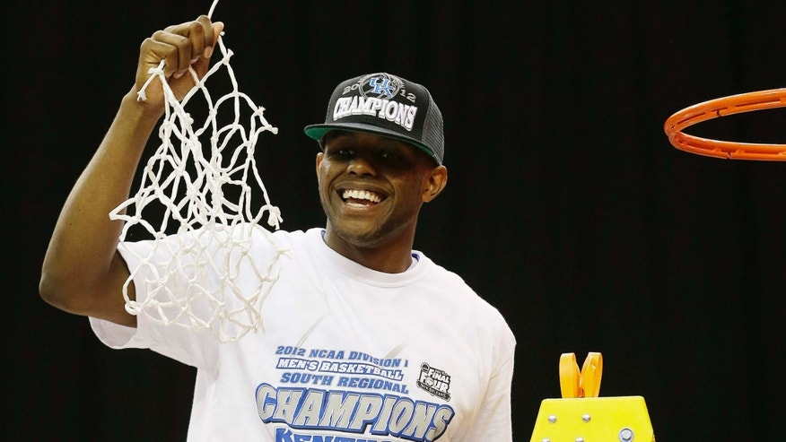 Kentucky's Terrence Jones hold the net after cutting it down after an NCAA tournament South Regional finals college basketball game against Baylor Sunday, March 25, 2012, in Atlanta. Kentucky won 82-70. (AP Photo/David J. Phillip)