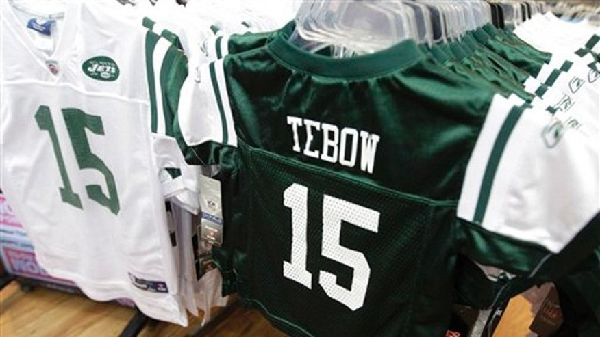 Reebok brand New York Jets football jerseys with the name and number of their new quarterback Tim Tebow hang on display at a Modell's store in New York.