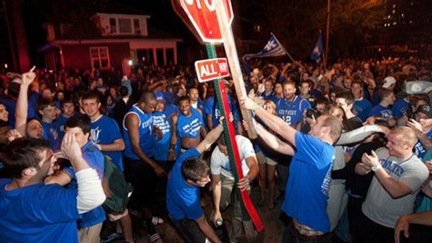 Mar. 31, 2012: Kentucky fans uproot a traffic sign on the corner of Elizabeth and State Streets as they celebrate Kentucky's 69-61 win over Louisville in an NCAA Final Four semifinal college basketball tournament game.