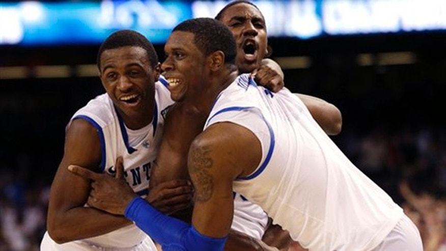 April 2, 2012: Kentucky guard Marquis Teague, right, celebrates with teammates at the end of the NCAA Final Four tournament college basketball championship game against Kansas.