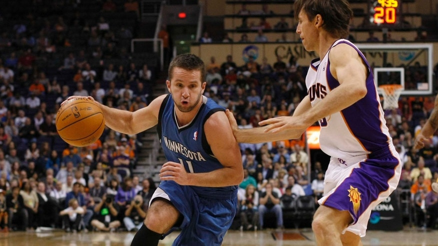 Minnesota Timberwolves guard Jose Barea, left, of Puerto Rico, drives on Phoenix Suns guard Steve Nash in the second quarter during an NBA basketball game on Monday, March 12, 2012, in Phoenix.