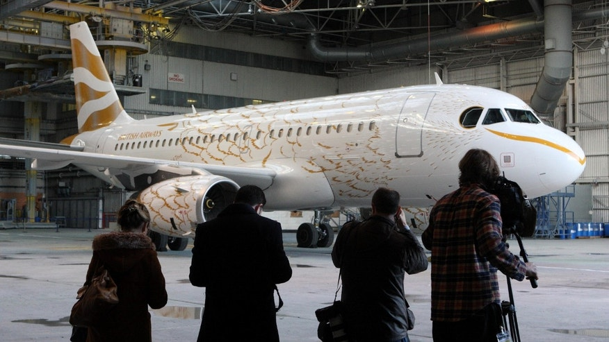 April 3: The British Airways Airbus A319, which has been painted to resemble a giant gold dove, is the first in a flock of Olympic-themed jets that will fly during this summer's London Games, at London's Heathrow Airport.  Artist Tracey Emin mentored designer Pascal Anson, who created the look of the plane.