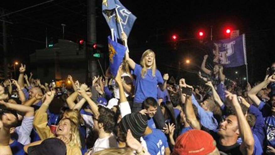 April 2, 2012: University of Kentucky fans celebrated after they watched the Wildcats defeat Kansas 67-59 in the Final Four championship game.