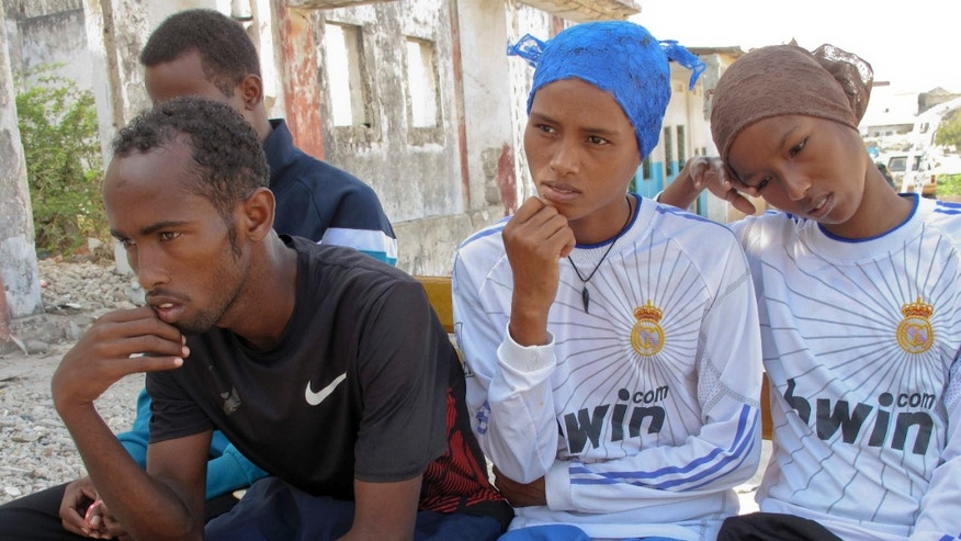 April 5, 2012: Four of the five Somali athletes chosen to attend the London Olympic Games, from left, runner Mohamud Ali, 5,000 meter runner Mohamed Hassan Mohamed, 5,000 meter runner Ayan Samow, and runner Amal Ahmed, mourn the deaths of two top Somali sports officials in Mogadishu, Somalia.