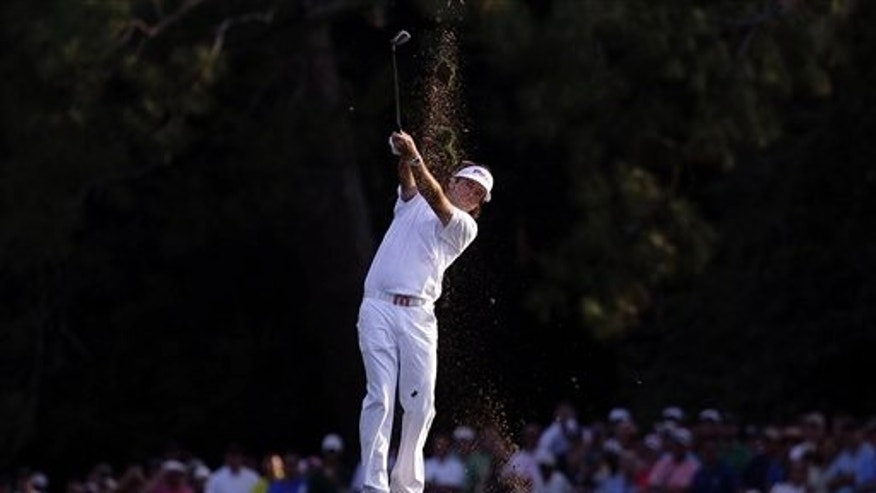 April 8: Bubba Watson hits off the 18th fairway during the fourth round of the Masters golf tournament in Augusta, Ga.