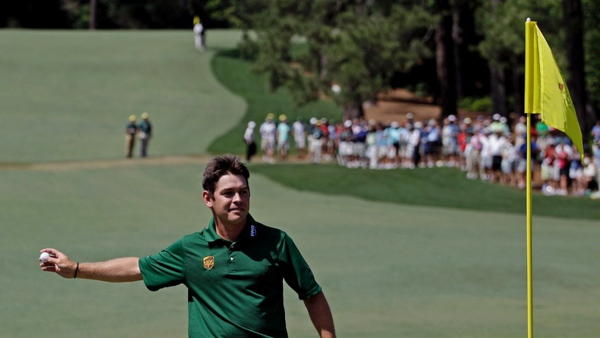 April 8, 2012: Louis Oosthuizen, of South Africa, throws his ball to a spectator after hitting an eagle two on the par 5 second hole during the fourth round of the Masters golf tournament in Augusta, Ga.