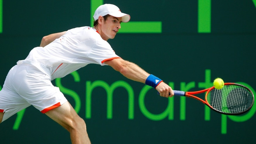 April 1, 2012: This photo shows Andy Murray, of Great Britain, returning the ball to Novak Djokovic, of Serbia, during the men's singles final match at the Sony Ericsson Open tennis tournament, in Key Biscayne, Florida.