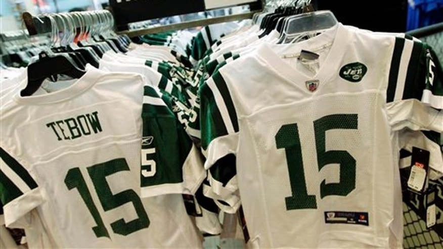 In this file photo, Reebok-branded New York Jets football jerseys with the name and number of Jets quarterback Tim Tebow are displayed at a Modell's store in New York.