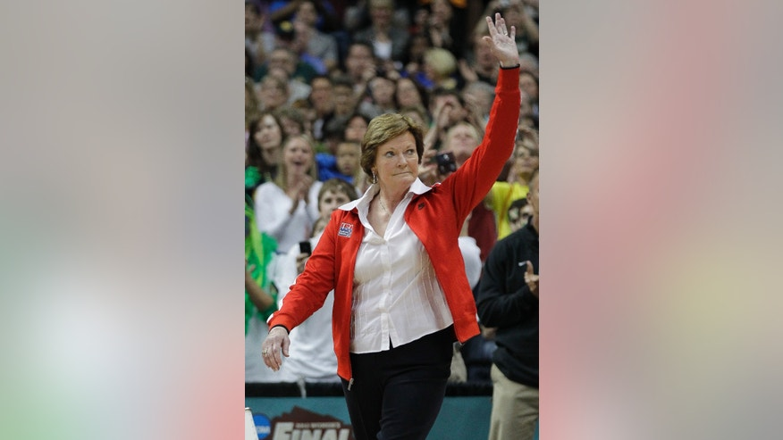 April 1, 2012: Tennessee coach Pat Summitt  waves to the crowd during a half-time ceremony to honor past Olympic coaches at an NCAA women's Final Four semifinal college basketball game between the Baylor and the Stanford, in Denver.