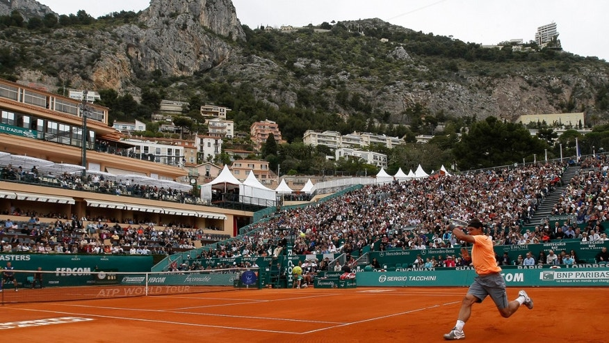 Spain's Rafael Nadal plays a return to Finland's Jarkko Nieminen, during their match of the Monte Carlo Tennis Masters tournament in Monaco, Wednesday, April 18, 2012. (AP Photo/Claude Paris)