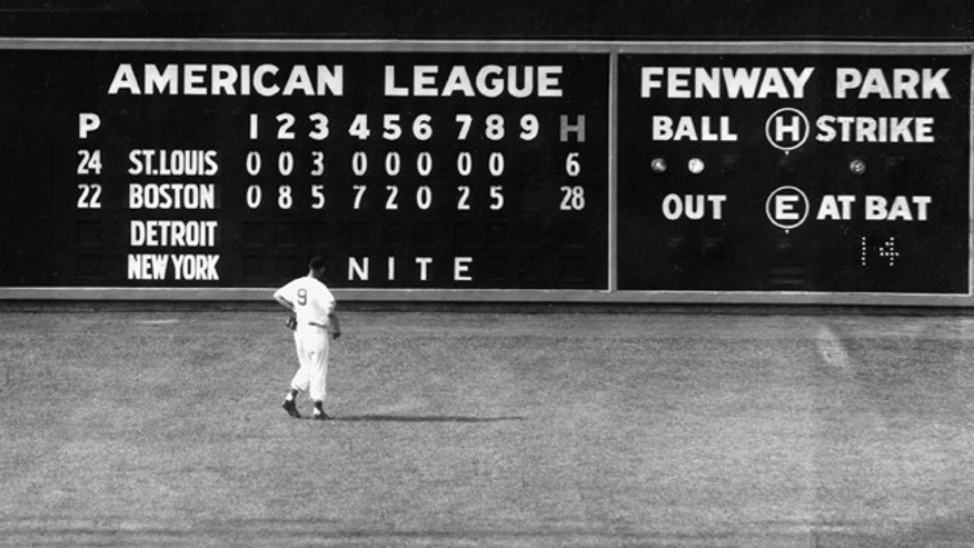 In this June 8, 1950, file photo, Boston Red Sox left fielder Ted Williams views the scoreboard on the left field wall at Fenway Park in Boston as the Red Sox were leading the St. Louis Browns 29-4. The Red Sox will celebrate the anniversary of Fenway's opening on April 20, 1912, when they host the New York Yankees. (AP)