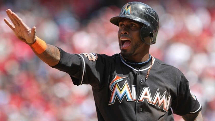 Miami Marlins' Jose Reyes asks for time after stealing third base in the first inning against the Philadelphia Phillies in a baseball game in Philadelphia on Monday, April 9, 2012. (AP Photo/The News-Journal, Daniel Sato)  NO SALES