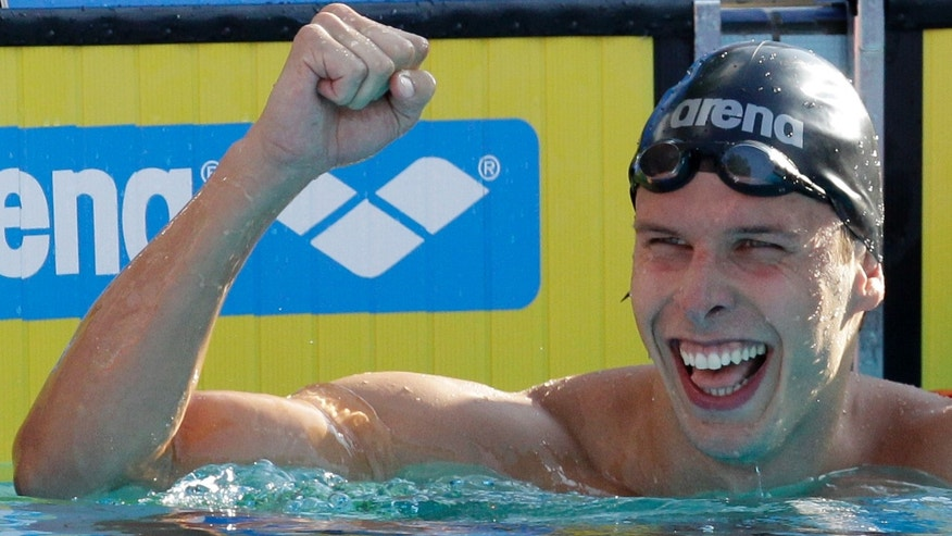 Aug. 10, 2010: In this file photo Norway's Alexander Dale Oen celebrates winning the gold medal in the Men's 100m breaststroke final at the Swimming European Championships in Budapest, Hungary.