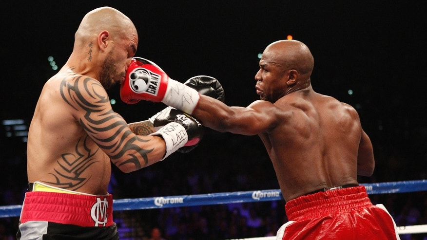 May 6, 2012: Floyd Mayweather Jr. hits Miguel Cotto during their WBA Super Welterweight title bout at the MGM Grand in Las Vegas.