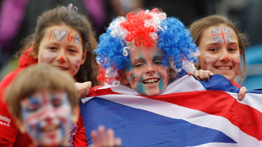 May 6, 2012: Young spectators show their support in Britain's team during the women's gold medal field hockey match between Britain and Argentina at the Riverbank field hockey arena in the Olympic Park in London.
