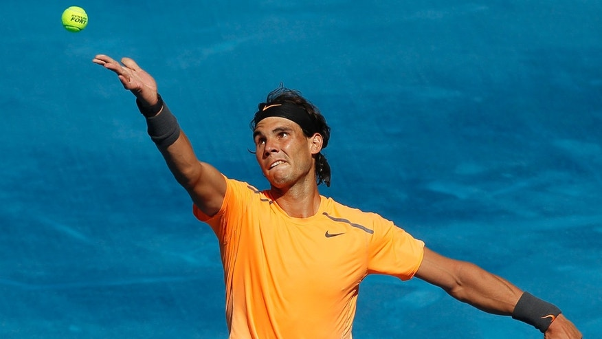 Rafael Nadal from Spain serves during a Madrid Open tennis tournament match against Nikolay Davydenko from Russia in Madrid, Wednesday, May 9, 2012. (AP Photo/Andres Kudacki)