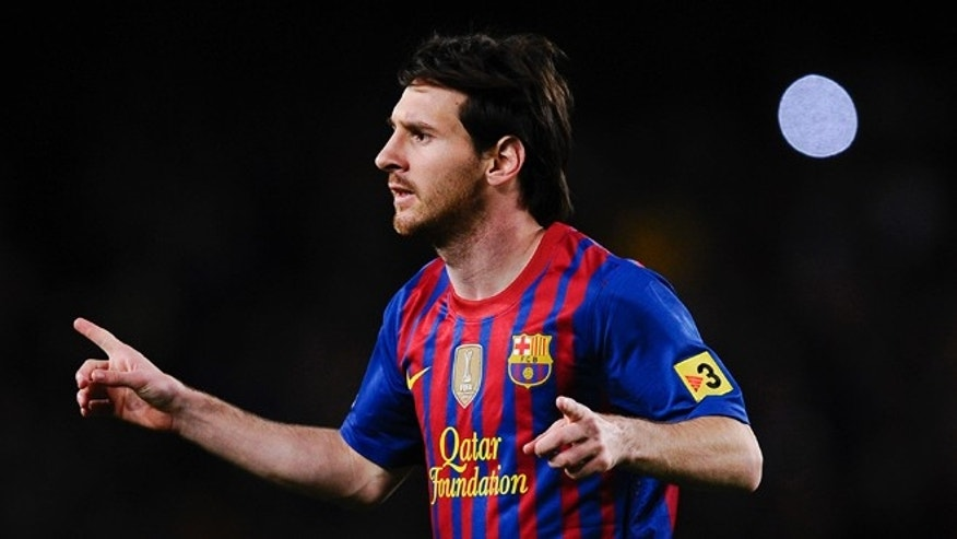 BARCELONA, SPAIN - MAY 05:  Lionel Messi of FC Barcelona celebrates after scoring the opening goal during the La Liga match between FC Barcelona and RCD Espanyol at Camp Nou on May 5, 2012 in Barcelona, Spain.