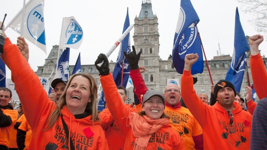 May 3, 2012: Union worker Melanie Tremblay, center, holds a petition of Rio Tinto Alcan locked out workers to be tabled at the legislature on Thursday,  in Quebec City.