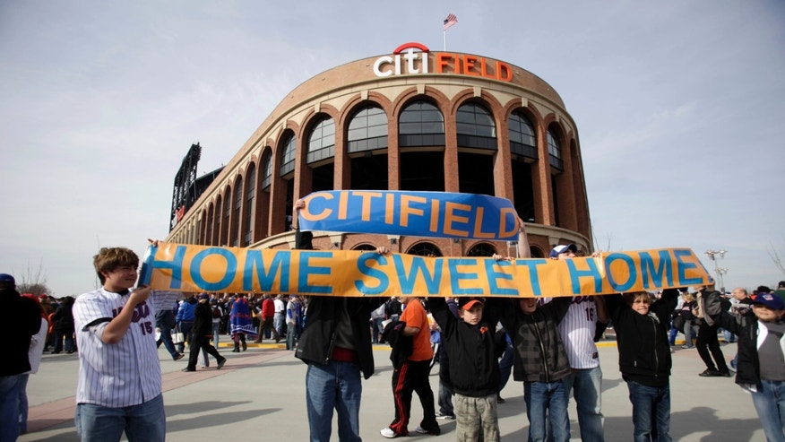 FILE - In this April 13, 2009, file photo, baseball fans hold up a sign in front of the Citi Field before the New York Mets' home-opening baseball game against the San Diego Padres  at Citi Field in New York. A person familiar with the announcement says Major League Baseball will announce Wednesday, May 16, 2012, that the Mets will host the 2013 All-Star game at Citi Field. The person spoke on condition of anonymity on Tuesday, May 15, because MLB did not reveal the purpose of Wednesday's news conference at City Hall in New York. (AP Photo/Seth Wenig, File)