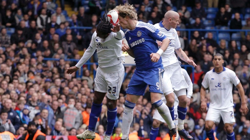 Chelsea's Fernando Torres, center, scores his second goal of the match during the English FA Cup quarterfinal soccer match between Leicester City and Chelsea at Stamford Bridge stadium in London, Sunday, March 18, 2012.