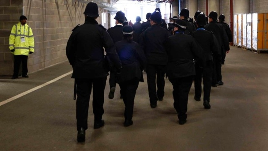May 5, 2012: British police officers walk through the inside of the main Olympic Stadium during the British Universities and Colleges Sport Athletics Championship at the Olympic Stadium in the Olympic Park in London.