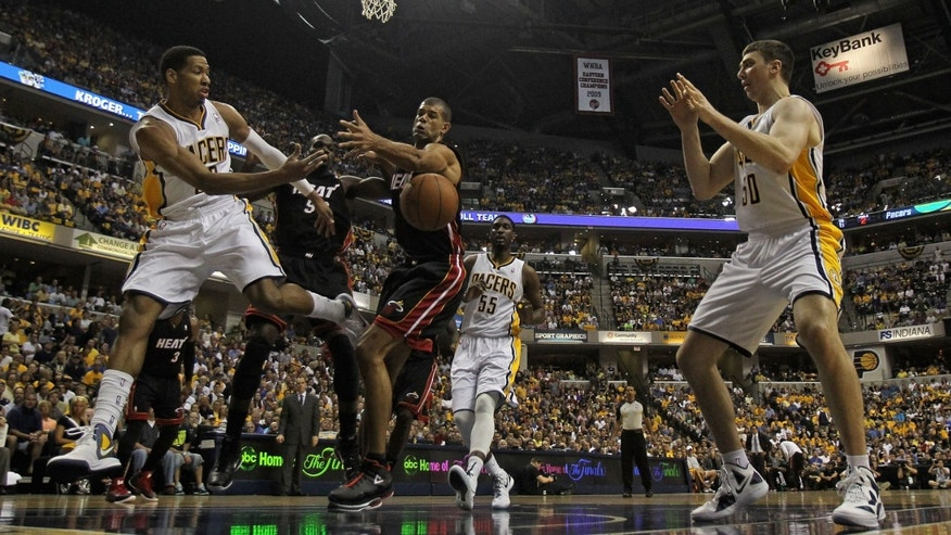 INDIANAPOLIS, IN: Danny Granger #33 of the Indiana Pacers passes the ball to Tyler Hansbrough #50 around Shane Battier #31 of the Miami Heat.