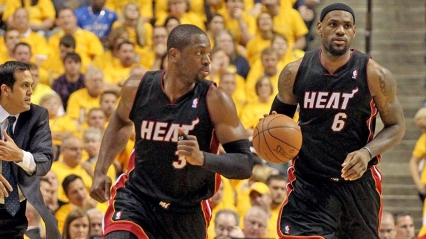 LeBron James drives the ball as Dwyane Wade leads in the third quarter. The Miami Heat vs Indiana Pacers for Game 6 of the Eastern Conference Semifinals at Bankers Life FieldHouse on Thursday, May 24, 2012. The Heat won 105-93 to win the series 4-2. (AP Photo/Al Diaz, Miami Herald)