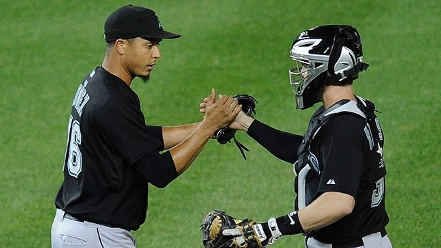 Sept. 17: Florida Marlins relief pitcher Leo Nunez celebrates 4-1 win over the Washington Nationals with catcher Brett Hayes, right, in a baseball game in Washington.