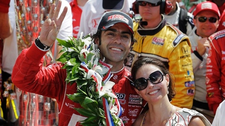 May 27, 2012: Dario Franchitti of Scotland celebrates in the victory circle with his wife, actress Ashley Judd, after winning the Indianapolis 500.