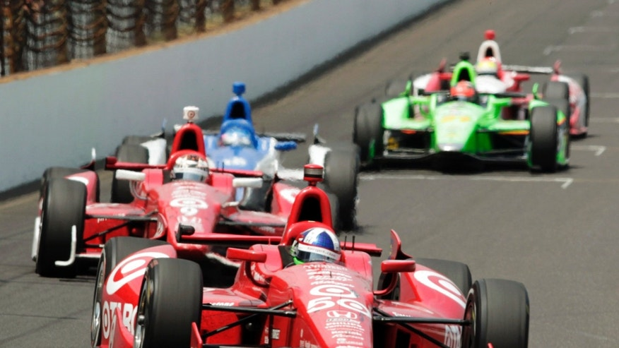 May 27: Dario Franchitti, of Scotland, leads into the first turn during Indianapolis 500.