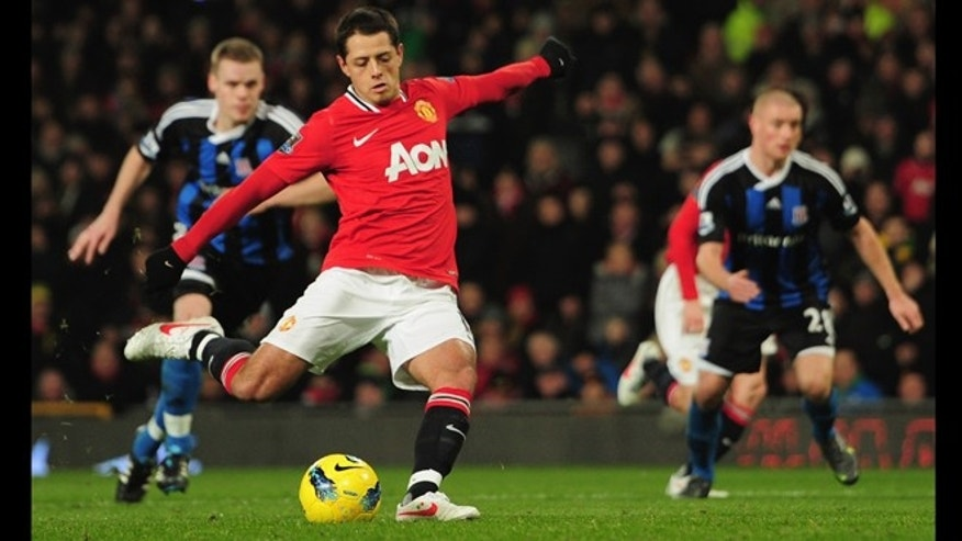 MANCHESTER, ENGLAND - JANUARY 31:  Chicharito of Manchester United scores a goal during the Barclays Premier League match between Manchester United and Stoke City at Old Trafford on January 31, 2012 in Manchester, England.  (Photo by Jamie McDonald/Getty Images)