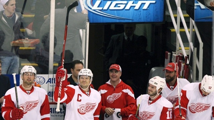 February 12, 2012: Detroit Red Wings Nicklas Lidstrom, second from the left, acknowledges the crowd after it was announced that he is playing his 1,550th game during the first period of their NHL hockey game against the Philadelphia Flyers in Detroit, Michigan.