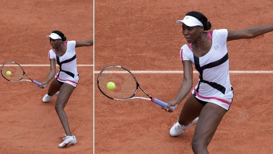 May 30, 2012: Venus Williams of the U.S. returns in her second round match against Agnieszka Radwanska of Poland at the French Open tennis tournament in Roland Garros stadium in Paris.