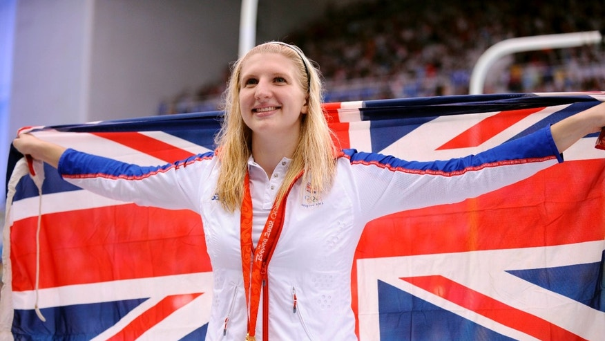 Aug. 16, 2008: In this file photo Britain's Rebecca Adlington shows her gold medal after the women's 800-meter freestyle semi-final during the swimming competitions in the National Aquatics Center at the Beijing 2008 Olympics.