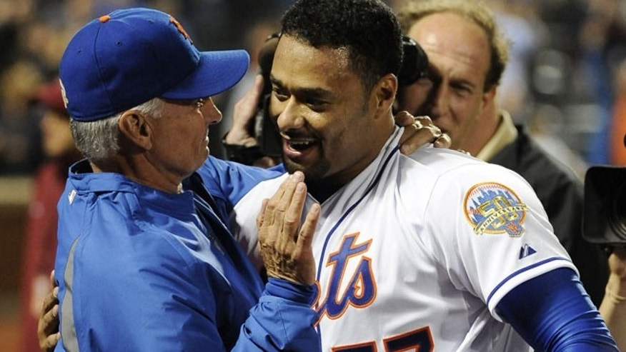 June 1, 2012: New York Mets starting pitcher Johan Santana (57) hugs manager Terry Collins after he threw a no-hitter against the St. Louis Cardinals in a baseball game at Citi Field in New York. The Mets won 8-0.