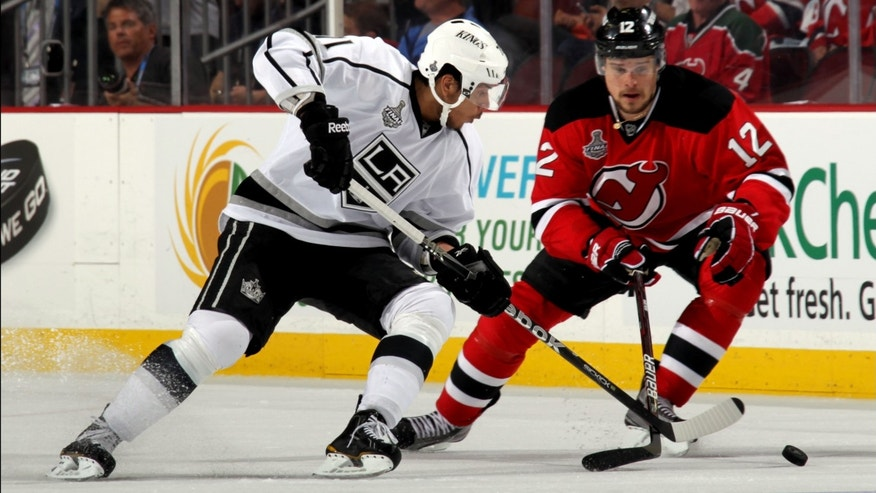 NEWARK, NJ - MAY 30:  Jordan Nolan #71 of the Los Angeles Kings skates for the puck against Alexei Ponikarovsky #12 of the New Jersey Devils during Game One of the 2012 NHL Stanley Cup Final at the Prudential Center on May 30, 2012 in Newark, New Jersey.  (Photo by Bruce Bennett/Getty Images) *** Local Caption *** Jordan Nolan; Alexei Ponikarovsky