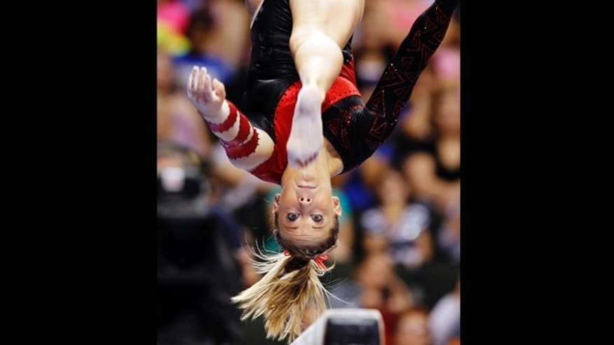Aug. 20, 2011: Shawn Johnson competes on the balance beam during the final round of the U.S. gymnastics championships in St. Paul, Minn. Johnson announced her retirement from competitive gymnastics Sunday, June 3, 2012, four days before the start of the U.S. championships.