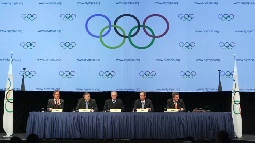 May 24, 2012: IOC Director of Communications Mark Adams (from left to right), IOC Executive Board member Richard L. Carrion, IOC President Jacques Rogge, USOC President Larry Probst and USOC Secretary General Scott Blackmun answer questions from the media.