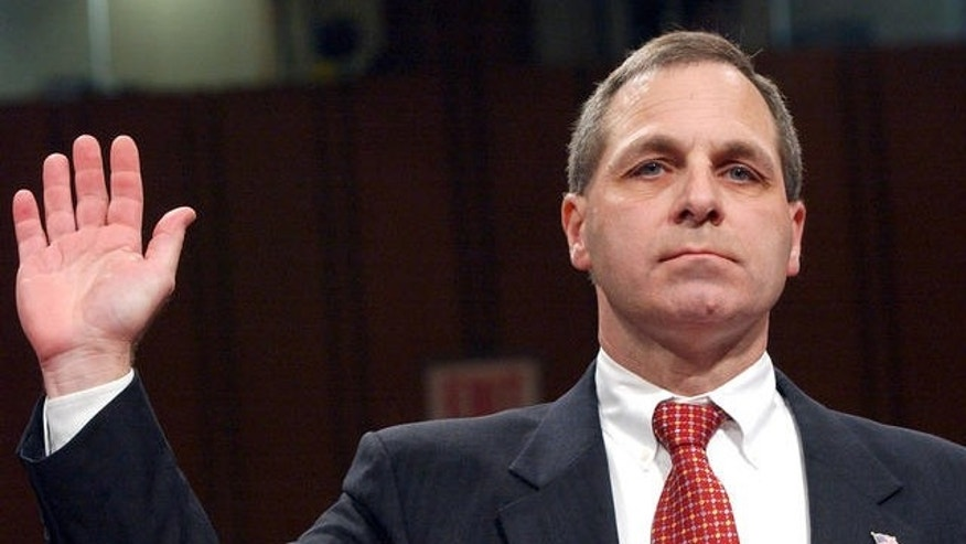 In this file photo, Louis Freeh, former FBI director, is sworn in at September 11th commission hearings on Capitol Hill in Washington DC.