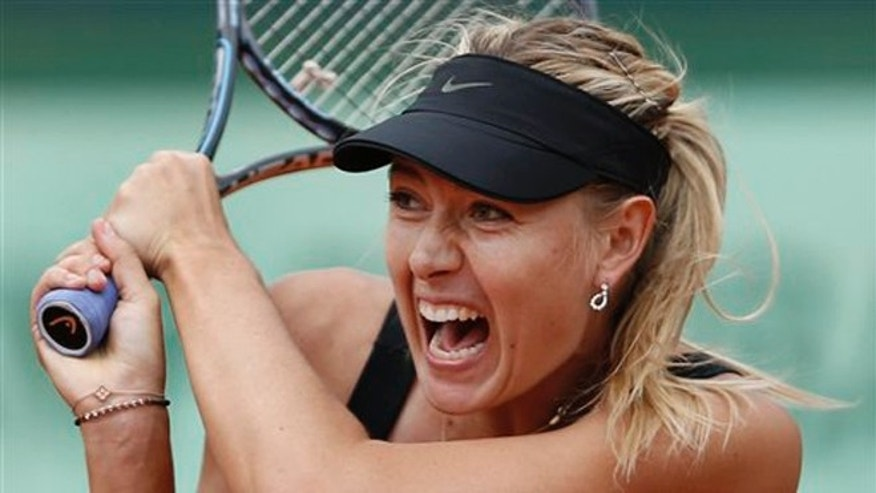 June 9, 2012: Maria Sharapova of Russia returns in the women's final match against Sara Errani of Italy at the French Open tennis tournament in Roland Garros stadium in Paris.
